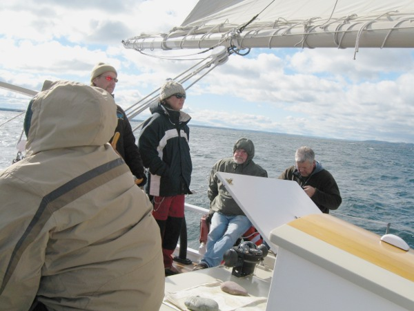 Captain Dave at the helm with Cheyenne at his side