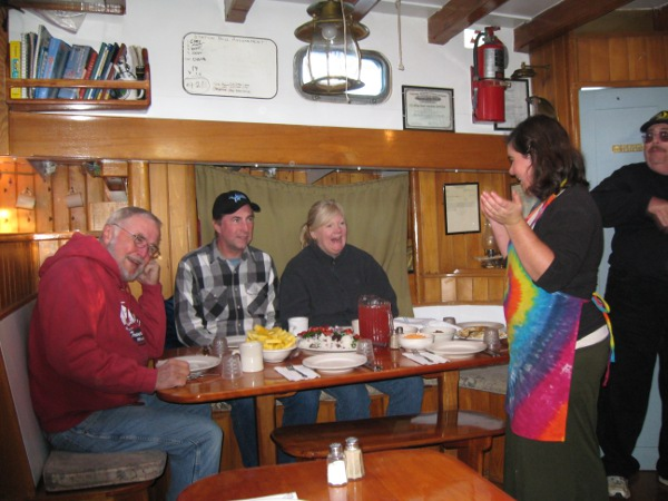 Lulu sharing a story before the meal with some passengers.