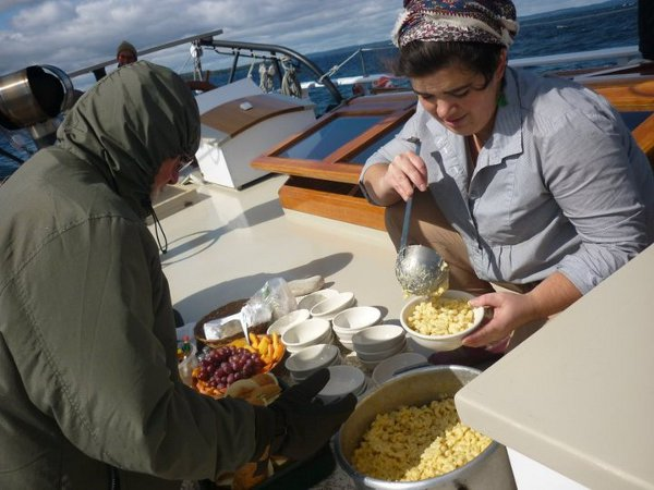 Lulu is dishing up macaroni and cheese for lunch.  Photo by Jin Newton