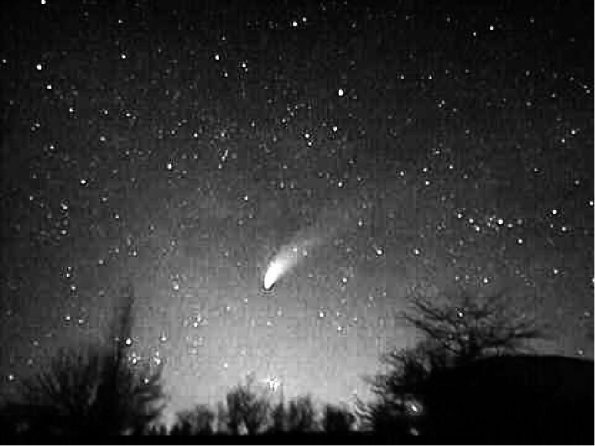 Zodiacal Light and Comet Hale-Bopp April 1997. Enhanced contrast.