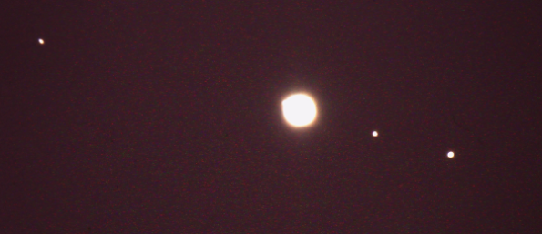 Overexposed Jupiter and its moons. My archival image.