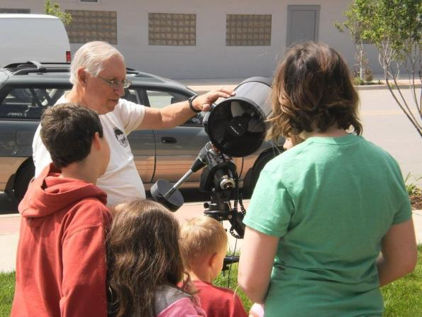 Here I am showing the kids how a telescope works.