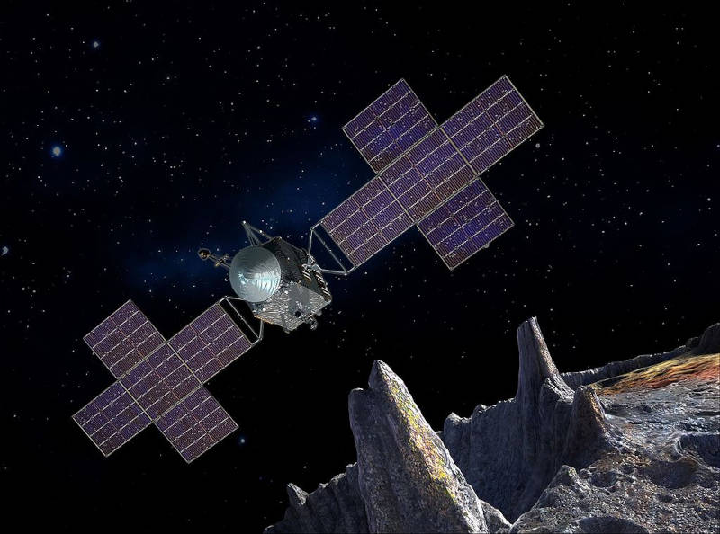 An artist's concept of the Psyche spacecraft orbiting the asteroid 16 Psyche