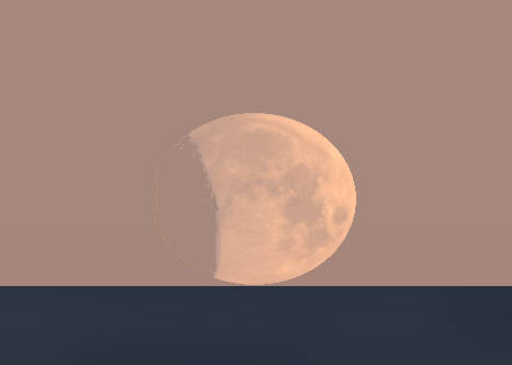 The partially eclipsed moon at moonset